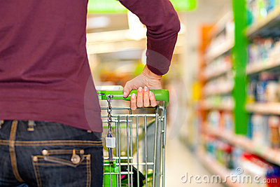 Woman In Supermarket With Shopping Cart Royalty Free Stock Photos - Image: 15210888