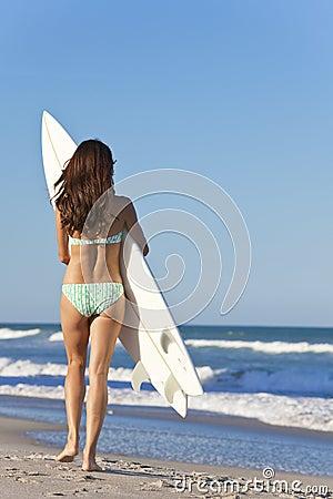 Woman Surfer in Bikini With Surfboard at Beach