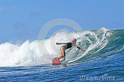 Woman Surfer Lane Davey surfing in Hawaii Editorial Image
