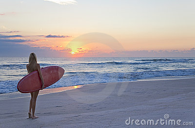 Woman Surfer & Surfboard At Sunset Sunrise Beach