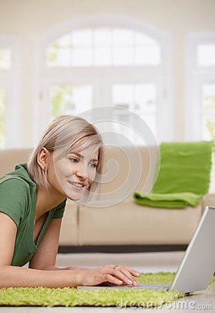 Woman surfing the internet at home