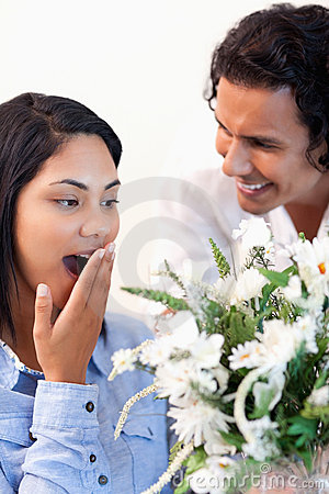 Woman surprised by the bouquet