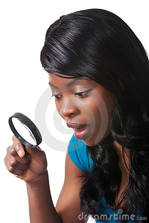 Woman surprised with magnifying glass