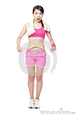 Woman surprised measuring waist