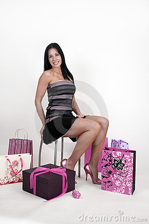 Woman surrounded by shopping bags