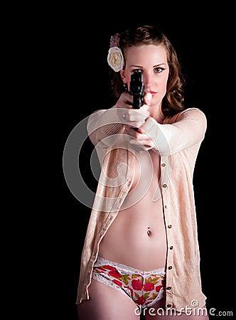 Woman in sweater aiming a gun