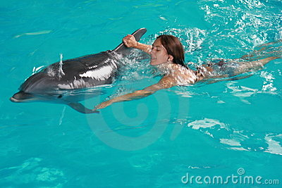 Woman swimming with dolphin