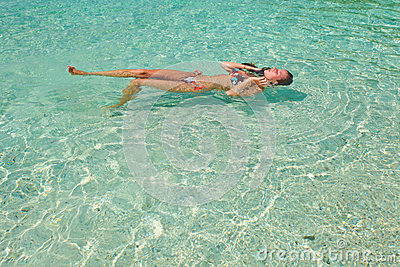 Woman in swimsuit in the water
