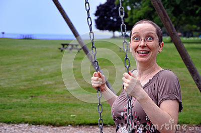 Woman on Swing with Surprise Expression
