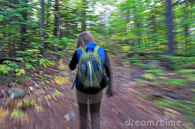 Woman Swooshing Down Hiking Trail