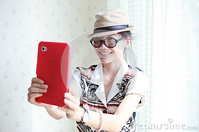 Woman take a photo by smart phone tablet