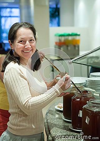 Woman takes fruit spread