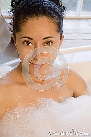 Woman taking bubble bath