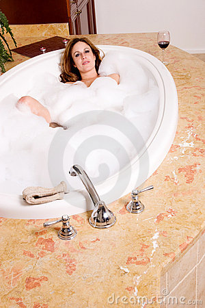 Woman taking bubble bath