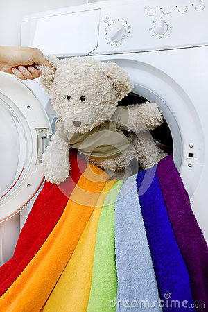 Free Woman Taking Fluffy Toy From Washing Machine Stock Image - 44562221