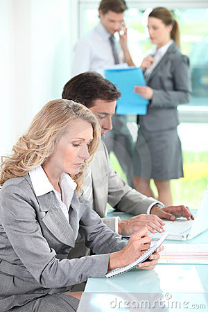 Woman taking notes in a meeting