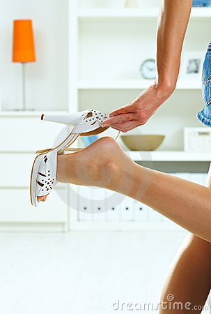 Woman Taking Off High Heel Shoe Royalty Free Stock
