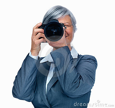 Woman taking out a photograph while isolated