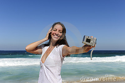 Woman taking a photo with a digital compact camera