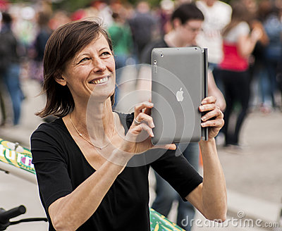 Woman Taking Photo with Ipad Editorial Photo