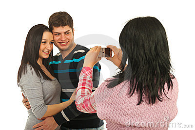 Woman taking photo to her friends couple