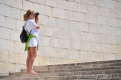 Woman taking photos on the street
