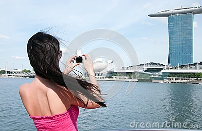Woman taking picture of Marina Bay hotel