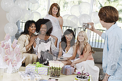 Woman Taking Pictures Of Friends At Bridal Shower