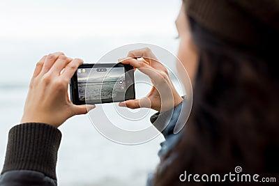 Woman taking pictures with Nokia Lumia 1020 Editorial Photo