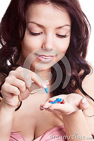 Woman taking pills