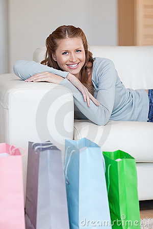 Woman taking a rest on the sofa after shopping tour