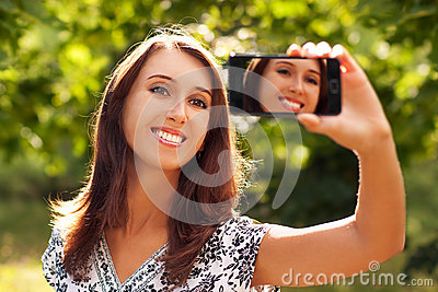Woman Taking Self Portrait with Phone Camera