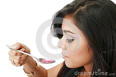 Woman taking syrup
