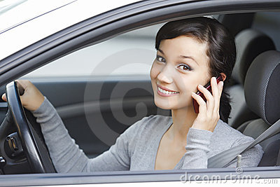 Woman talk on cell phone sitting in car