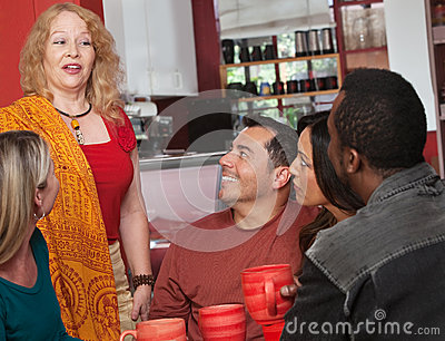 Woman Talking with Friends in Cafe