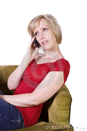 Woman talking on mobile phone at her home