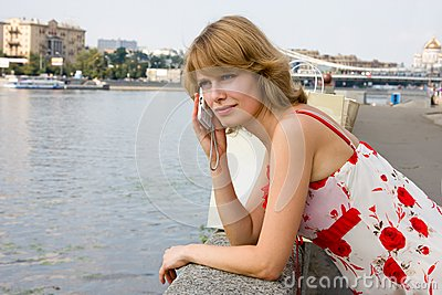 Woman Is Talking Mobile Phone Outdoors. Royalty Free Stock Photos - Image: 15333138