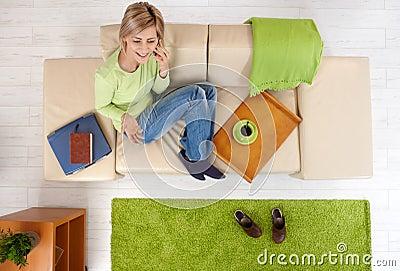 Woman talking on phone on sofa