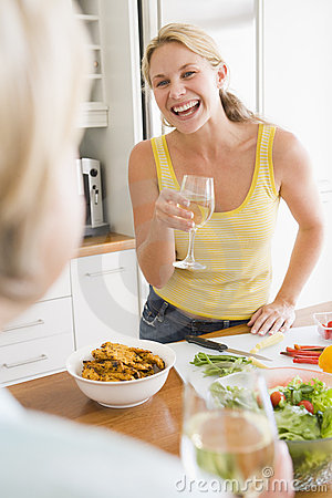 Woman Talking To Friend While Preparing meal