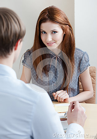 Woman talks with man at the coffee bar