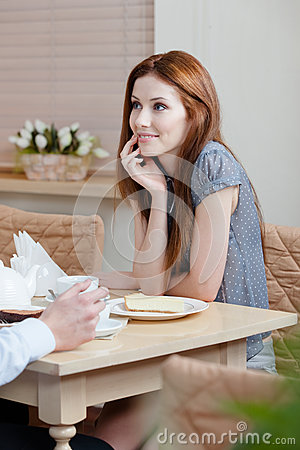 Woman talks with man at the shop