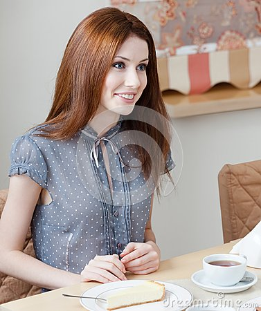 Woman talks with someone at the coffee house