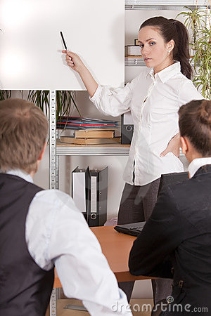 Woman talks to audience in office