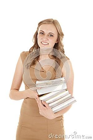 Woman tan dress stack books