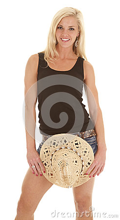 Woman tank top hold cowgirl hat down