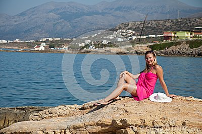 Woman tanning on exotic beach