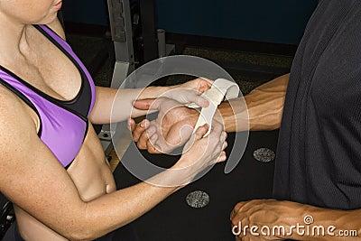 Woman taping wrist.