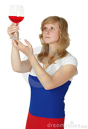 Woman - taster checks color and opacity of wine