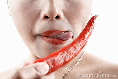 Woman tasting big red chili
