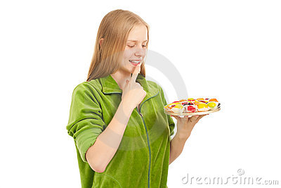 Woman tasting variety of fruits and berries